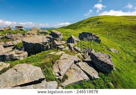 Huge Boulders On The Edge Of Hillside. Fine Weather In Summer Mountain Landscape