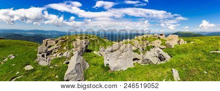 Rocks Of Runa Mountain. Panoramic View. Wonderful Cloudscape On A Blue Sky Over The Distant Mountain