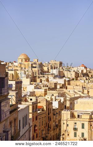 Scenic Urban View From The Old City Of Valletta. Travel Photo Of The Old Neighborhoods Of The Maltes