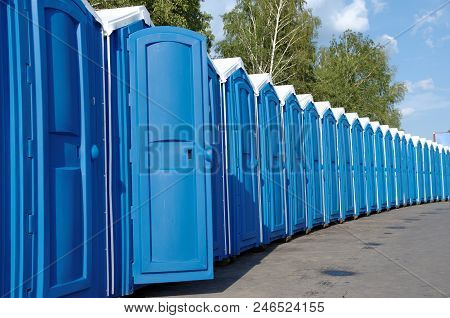 A Line Of Portable Toilets In The Street.
