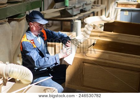 Belarus, The City Of Gomel, On April 26, 2018. Furniture Factory. The Worker Makes Furniture. Manufa