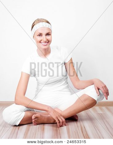beautiful young sporty woman working out at home poster