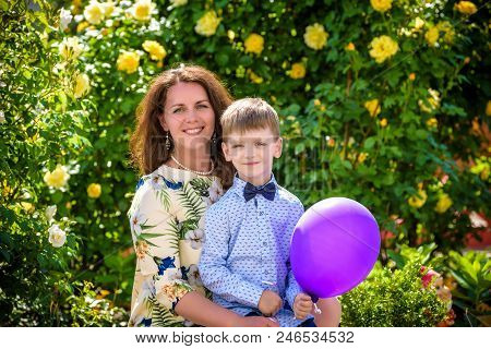 Woman And Child With Baloon Against Green Background. Spring Family Holiday Concept. Mother Day