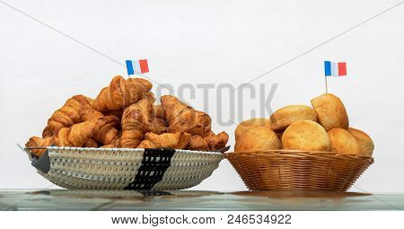 Baskets With 2 French Style Pastry, Basket Witch French Croissants. A Little French Flags On The Top