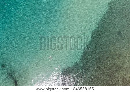 Aerial View Of A Girl Swimming In The Sea