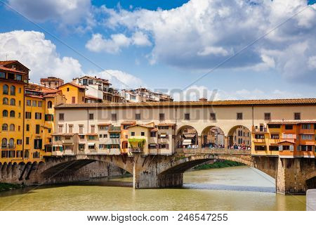 Picturesque Ponte Vecchio (Old Bridge) medieval bridge with Vasari Corridor (Corridoio Vasariano) elevated enclosed passageway  over the Arno River, a popular tourist attraction of  Florence, Tuscany