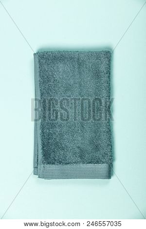 Clean towel on blue background, flat lay