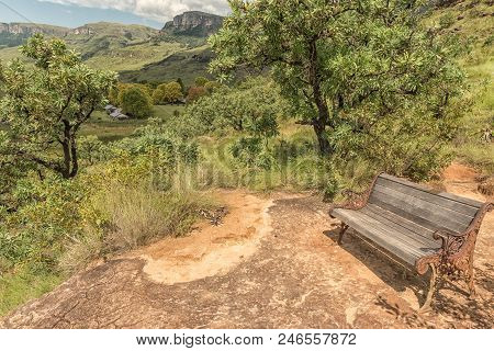 Injisuthi, South Africa - March 19, 2018: A Bench On A Hill, With The Rest Camp At Injisuthi In The