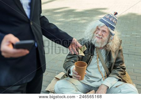 Nice Attention. Smiling Broadly Street Person Feeling Extremely Happy While Receiving Attention From