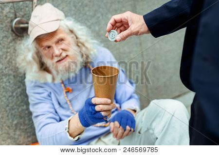 Sympathetic Man. Sympathetic Kind-hearted Businessman Providing Homeless Man With Token For Undergro