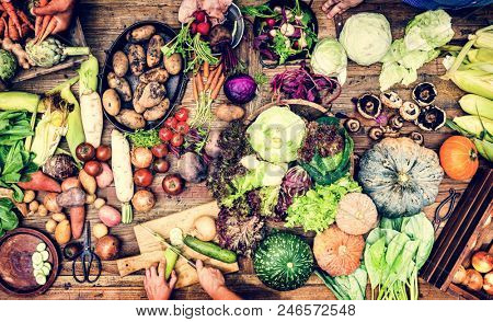 Aerial view of fresh organic various vegetable on wooden table