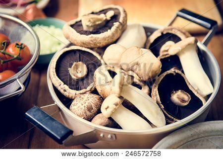 Closeup of fresh eryngii and portobello mushroom