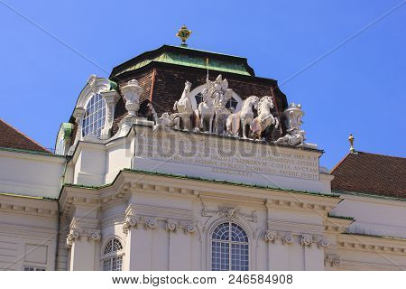 Statues on the top of Hofburg Imperial Palace in Vienna poster