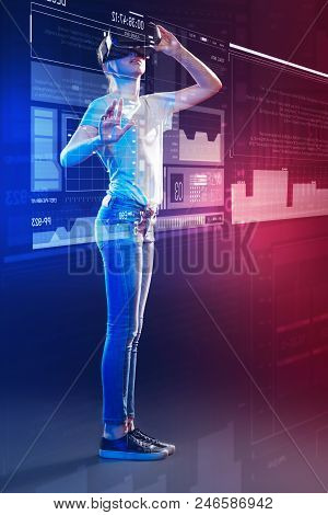 Progressive Girl. Clever Progressive Girl Using Virtual Reality Glasses While Standing In Front Of A