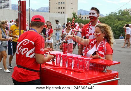 Marseille, France - June 21, 2016: Polish Fans Buy Drinks At A Coca-cola Beverage Kiosk Near The Sta