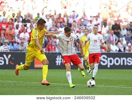 Marseille, France - June 21, 2016: Yevhen Khacheridi Of Ukraine (l) Fights For A Ball With Robert Le