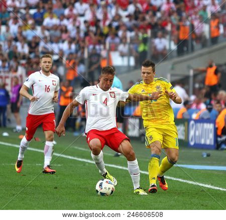 Marseille, France - June 21, 2016: Thiago Cionek Of Poland (l) Fights For A Ball With Yevhen Konoply