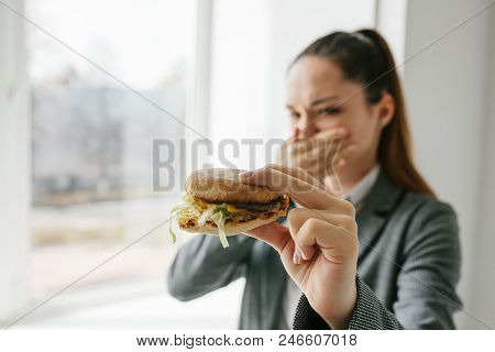 A Young Girl Shows That She Does Not Like A Burger.conceptual Image Of Refusal From Unhealthy Eating