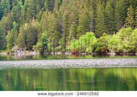 Reflection Of Tatra Mountain Peaks In Morskie Oko Lake. Eye Of The Sea Lake In Tatra Mountains, Pola