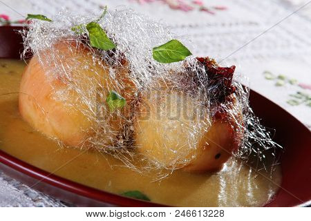 Baked Apple In Sirup With Sugar Floss