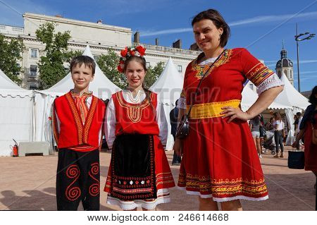 Lyon, France, June 23, 2018 : Family In Traditional Dress From Bulgaria. The Fetes Consulaires Stand