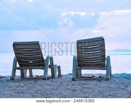 Beach Lounge Chairs At Tropical Sea Beach Background In Summer Landscape.