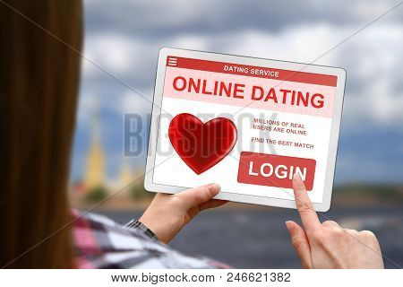 Online Dating Concept, Girl With Tablet Pc On Blurred Clouds Background