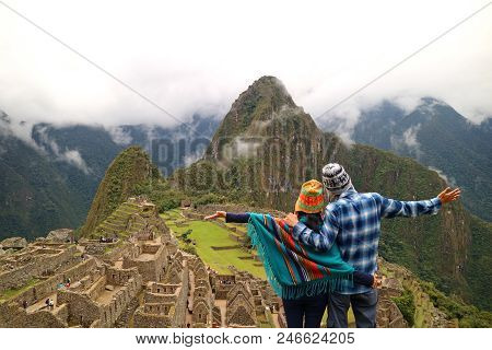 Couple Admiring The Spectacular View Of Machu Picchu, Cusco Region, Urubamba Province, Peru, Archaeo