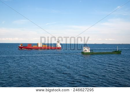 Barges Ship Cargo Containers In Sea In Copenhagen, Denmark. Cargo Ships Float In Blue Sea On Idyllic