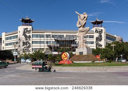 Dunhuang, China - August 7, 2012: Street Scene In The City Of Dunhuang, With A Roundabout With A Sta