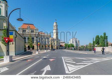Oradea, Romania - 28 April, 2018: People Walking On The Street With Oradea City Hall In Background.