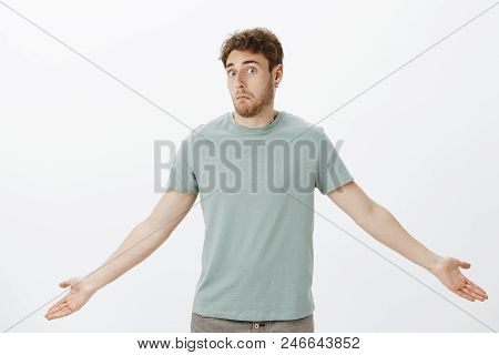 Guy Feeling Confused After Loosing Wallet. Portrait Of Questioned Timid Attractive Man In T-shirt, S