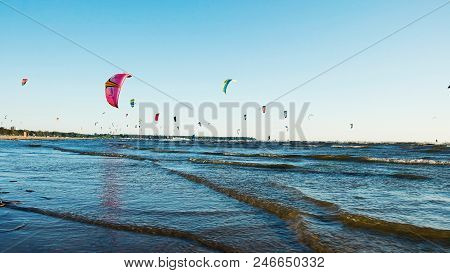 Kitesurfing In The Summer At Sea In Windy Weather, Extreme Rest. Camera Movement Along The Coast, Sl