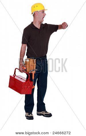 A yawing handyman looking at his watch.