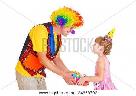 Girl in party hat receiving her birthday presents from a clown