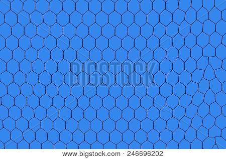 silhouetted iron net against a deep blue sky