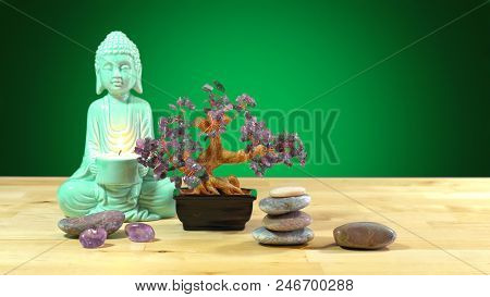 Calming Zen Interiors Table Setting With Buddha Statue Holding Burning Candle, Crystals, Rocks Again
