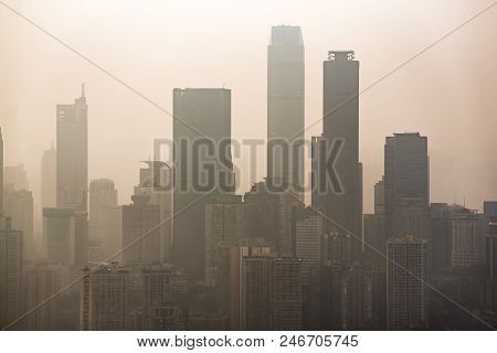 Big City Skyline In Smog With Skyscrapers Silouhettes
