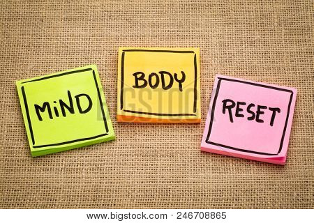 mind and body reset - handwriting on sticky notes against burlap canvas poster