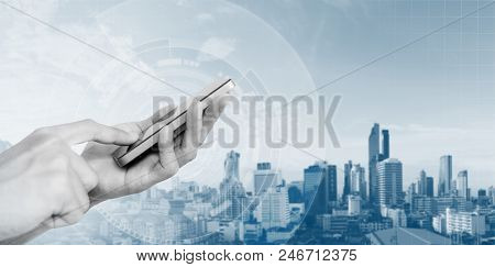 Mobile Smart Phone Technology, Hand Touching Mobile Phone And City Background