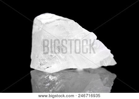 White Calcite Mineral Stone In Front Of Black Background, Polymorph Calcium Carbonate