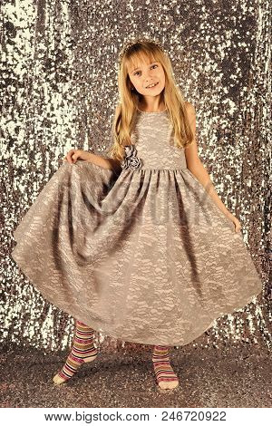 Kid's Fashion. Little Girl In Fashionable Dress, Prom. Fashion Model On Silver Background, Beauty. L