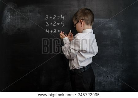 Young Kid's Solving Elementary Maths Expression. Back To School Concept. Smart And Clever Preschool