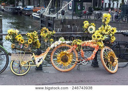 Flower Bike On A Bridge In Amsterdam