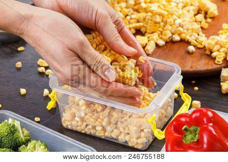 Chef Puts Corn Into The Freezing Tray. Storage In Plastic Containers