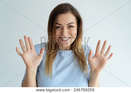 Smiling Cute Woman Showing Palms. Positive Lady Looking At Camera. Carelessness Concept. Isolated Fr
