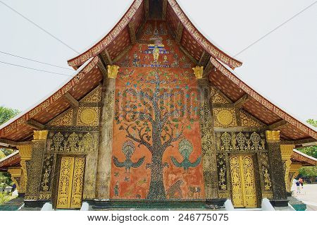 Luang Prabang, Laos - April 14, 2012: Exterior Wall With Beautiful Tree Mosaic Of The Pavilion At Xi