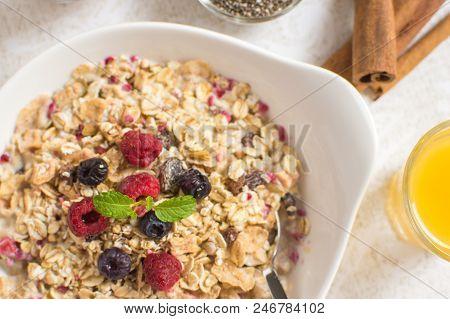 Muesli With Milk, Chia Seeds, Berries And Cinnamon As Healthy Breakfast