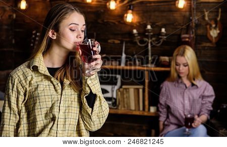 Friends Enjoy Mulled Wine In Warm Atmosphere, Wooden Interior. Girls Relaxing And Drinking Mulled Wi