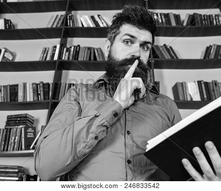 Teacher Or Student With Beard Studying In Library. Scientist Busy With Exploring Book. Man On Busy F